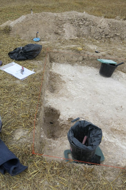 The two post holes (?) at the top of the main trench - quite busy by the look of it, a lot of tidying up going on.